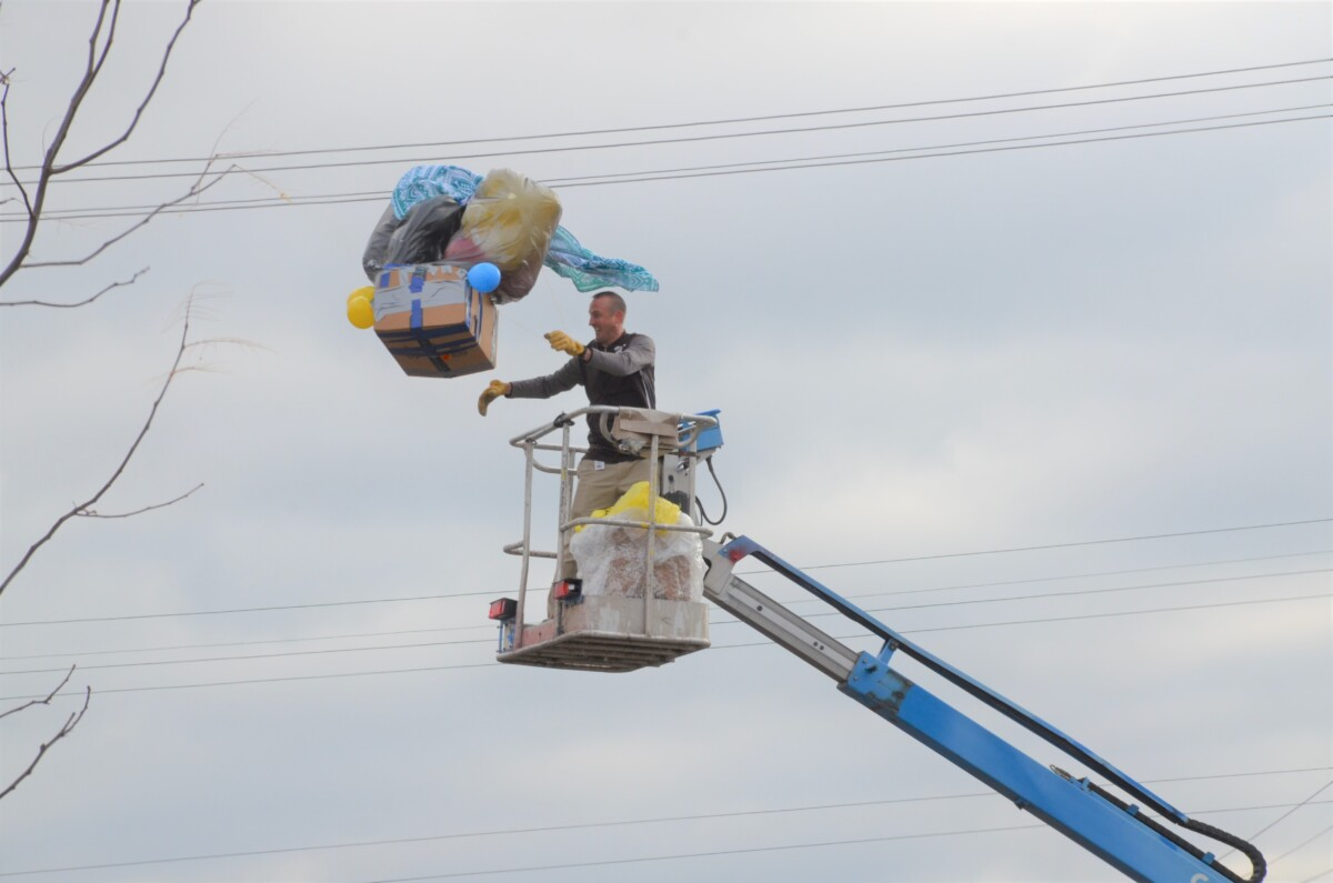 Packaged pumpkin being dropped from crane