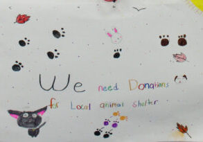 """Poster made by a student that features paw prints, a cat, bunny, dog and the words """"We need donations for local animal shelter."""""""